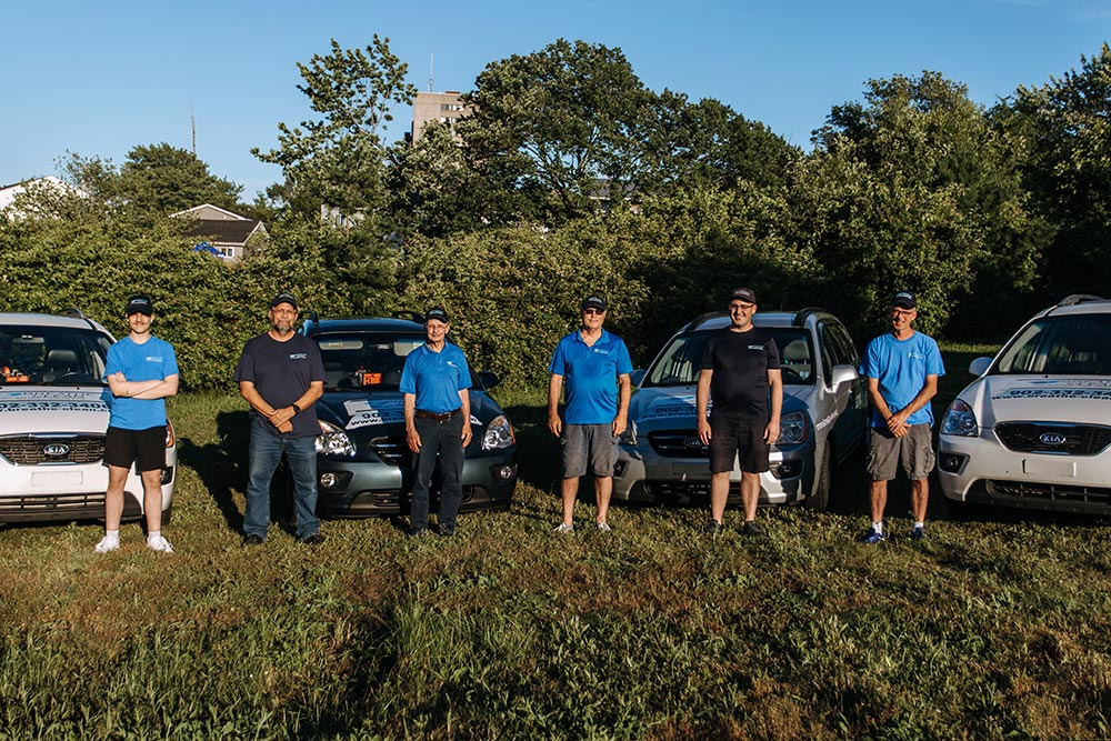 The Breathe Clean team in front of their vehicles